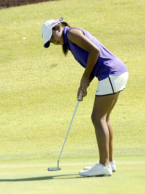 Clarksville senior Mariah Smith watches her putt on the 18th green. Smith shot 68 in the Class AAA tournament on Oct. 12, 2016.
