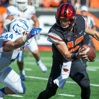 Sep 24, 2016; Corvallis, OR, USA; /Oregon State Beavers quarterback Conor Blount (12) dodges Boise State Broncos linebacker Darren Lee (44) during the fourth quarter at Reser Stadium. Mandatory Credit: Cole Elsasser-USA TODAY Sports