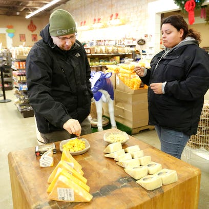 Jesse and Nellie of Chicago sample cheese at the Mars