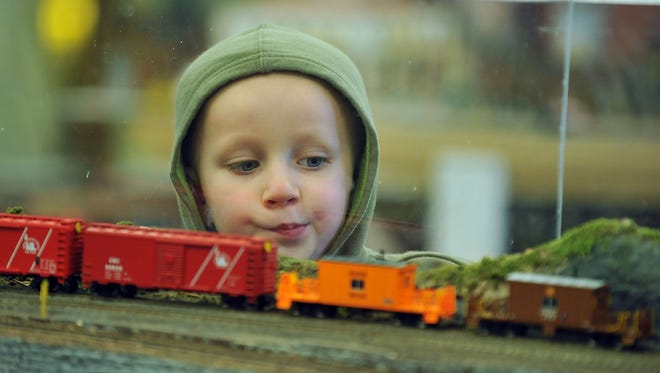 Gregory Heilan, 4, of Hammonton, watches an HO scale model pass during the open house at Patcong Valley Model Railroad Club.
