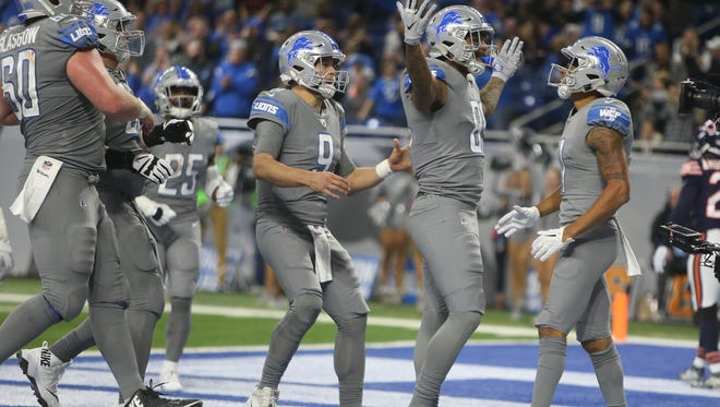 Lions QB Matthew Stafford (9), TE Eric Ebron (85) and WR Marvin Jones Jr. (11) celebrate Ebron's touchdown during the third quarter of the Lions' 20-10 win on Saturday, Dec. 16, 2017, at Ford Field.