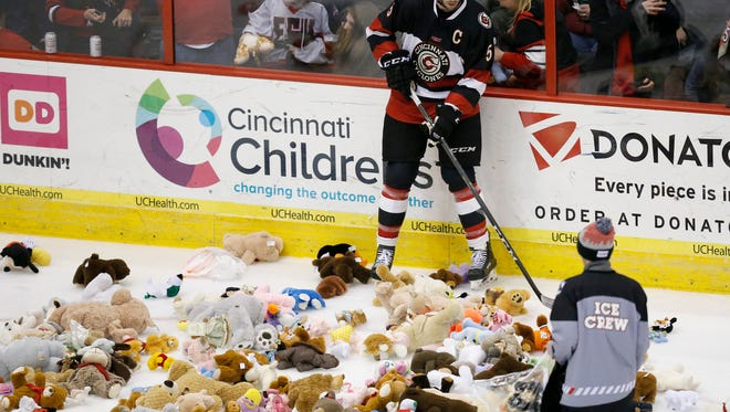 Fans throw teddy bears on the ice following the Cyclones first goal of the night in the second period of the EHL hockey game between the Cincinnati Cyclones and the Wheeling Nailers at US Bank Arena in downtown Cincinnati on Saturday, Jan. 6, 2018. Collected teddy bears are donated to the Cincinnati Police Department to be used for comforting children in need.