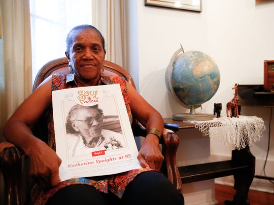Althemese Barnes, founding director of the Riley Foundation, sits in the Riley House with a poster promoting her new project, which centers around the oral history of Katherine Speights, a Tallahassee resident who grew up during the era of Jim Crow and the Civil Rights movement.