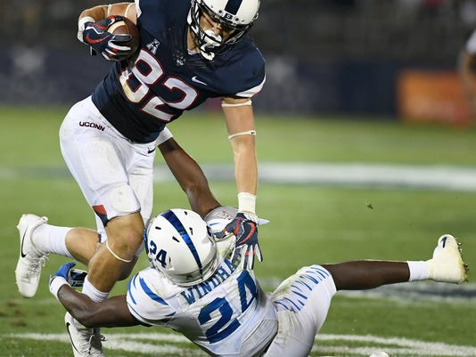 Memphis defensive back Tito Windham (24) tackles Connecticut wide receiver Mason Donaldson (82) during the second half of an NCAA college football game, Friday, Oct. 6, 2017, in East Hartford, Conn. (AP Photo/Jessica Hill)