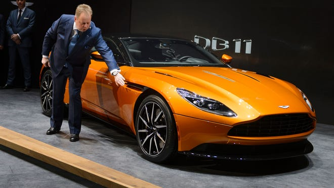 Aston Martin CEO Andy Palmer shows the new DB11