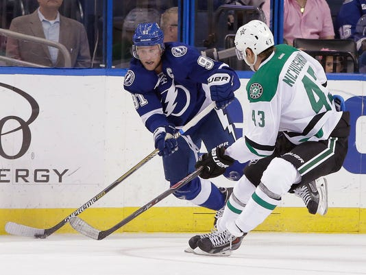 Tampa Bay Lightning center Steven Stamkos (91) controls the puck in front of Dallas Stars right wing Valeri Nichushkin (43), of Russia, during the first period of an NHL preseason hockey game Friday, Sept. 26, 2014, in Tampa, Fla. (AP Photo/Chris O'Meara)