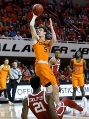 Oklahoma State forward Duncan Demuth (5) goes to the basket in front of Oklahoma forward Kristian Doolittle (21) during the first half of an NCAA college basketball game in Stillwater, Okla., Wednesday, Jan. 23, 2019. (AP Photo/Sue Ogrocki)