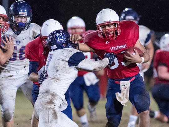 Strathmore's Joseph Garcia attempts to shed a tackle