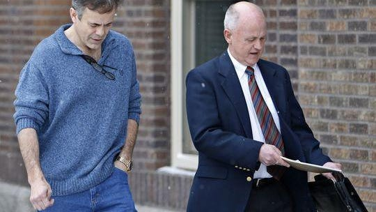 Joop Bollen leaves the Brown County Courthouse with his lawyer, Reed Rasmussen, earlier this year.