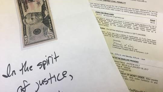 Rep. Andy Holt (R-Dresden) paid two traffic camera tickets on Facebook Live Thursday with Monopoly money and a photographed image of a $50 bill.