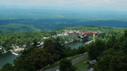 The Mohonk Mountain House in New Paltz sits snugly beside a glacial lake.