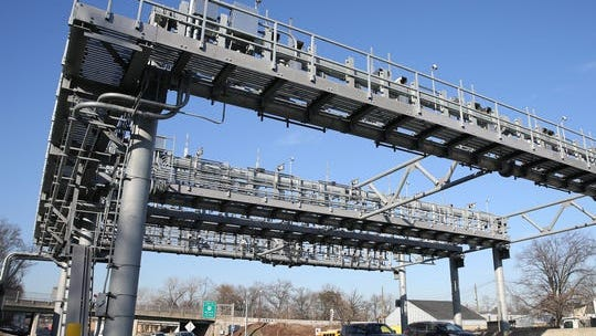 Cars pass under the cashless-toll gantry on the New York State Thruway at the Mario M. Cuomo Bridge photographed on Wednesday, January 10, 2018.