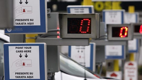 The NEXUS card, with an embedded radio frequency identification chip, allows pre-screened travelers expedited processing though dedicated traffic lanes between the U.S. and Canada.