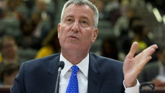 New York City Mayor Bill de Blasio, shown here in this file photo, announced Sunday he would limit bars and restaurants to takeout and delivery as the city tries to slow the spread of the novel coronavirus; March 15, 2020.