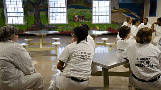 Inmates sit in the visitation area at Tutwiler Women's Correction Facility in Wetumpka on Feb. 6, 2017.