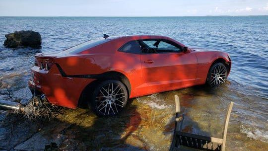 Jermiah Braswell was arrested Saturday evening after Put-in-Bay police received a call that someone had driven this Chevrolet Camaro into Lake Erie.
