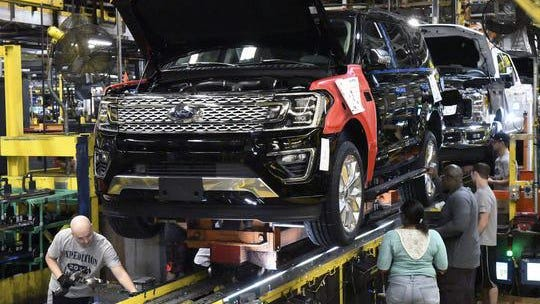 Workers assemble Ford trucks at the Ford Kentucky Truck Plant in Louisville, Ky. in October 2017.