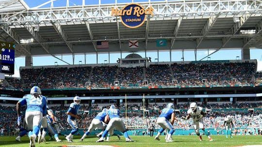 Oct 21, 2018; Miami Gardens, FL, USA; Detroit Lions quarterback Matthew Stafford (9) hands the ball off to Detroit Lions running back LeGarrette Blount (29) against the Miami Dolphins at Hard Rock Stadium. Mandatory Credit: Steve Mitchell-USA TODAY Sports