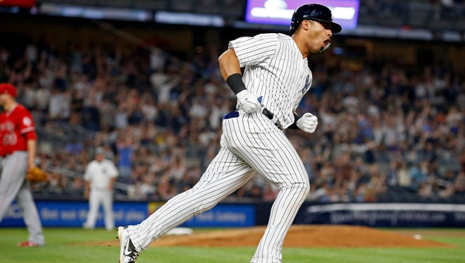 New York Yankees second baseman Gleyber Torres (25) celebrates a solo home run off of Los Angeles Angels relief pitcher Jim Johnson (33) during the seventh inning at Yankee Stadium.
