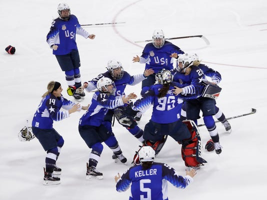 United States celebrates winning gold in the women's gold medal hockey game against Canada at the 2018 Winter Olympics in Gangneung, South Korea, Thursday, Feb. 22, 2018. (AP Photo/Matt Slocum)