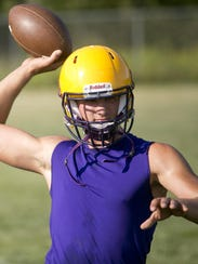 Jake Allind throws the ball during football practice