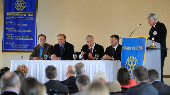 Independent Gordon Howie, Democrat Rick Weiland, Independent Larry Pressler and Republican Mike Rounds answer questions from Jack Marsh at the Holiday Inn City Center in downtown Sioux Falls, S.D., Monday, Oct. 13, 2014.