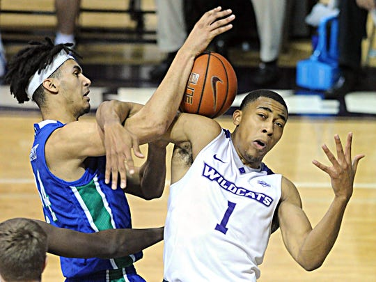 ACU's Jaren Lewis, right, gets tangled up with Texas A&M-Corpus Christi's Elijah Schmidt with battling for a rebound. The Islanders beat ACU 76-67 on Thursday, Feb. 22, 2018 at Moody Coliseum.