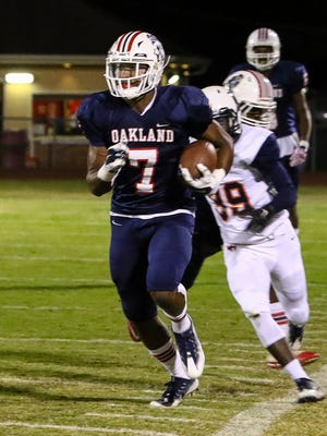 Oakland's JaCoby Stevens runs the sidelines en route to a touchdown during Friday's win over William Blount.