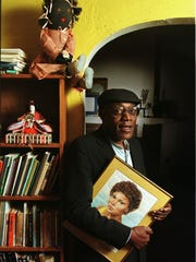 James Alan McPherson holds a drawing of his daughter,