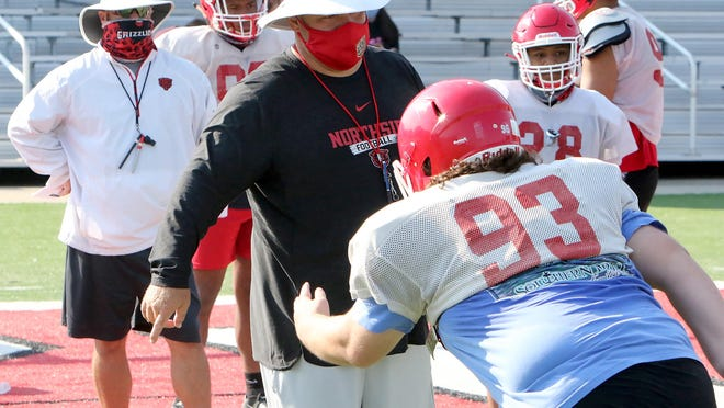 Northside assistant coach Chad Frazier works with players on Thursday, August 6, 2020, at Mayo-Thompson Stadium.