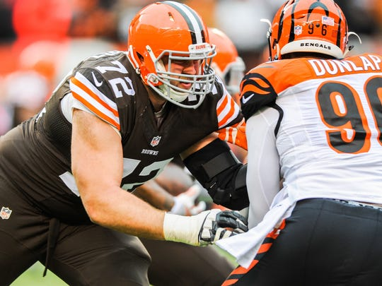 Cleveland Browns tackle Mitchell Schwartz (72) and Cincinnati Bengals defensive end Carlos Dunlap (96) at FirstEnergy Stadium.