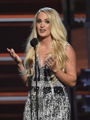 Carrie Underwood accepts the award for vocal event
