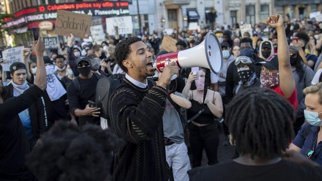 Ohio State and former Northland basketball player Seth Towns gives an impassioned speech to protesters during a protest Downtown last Sunday.