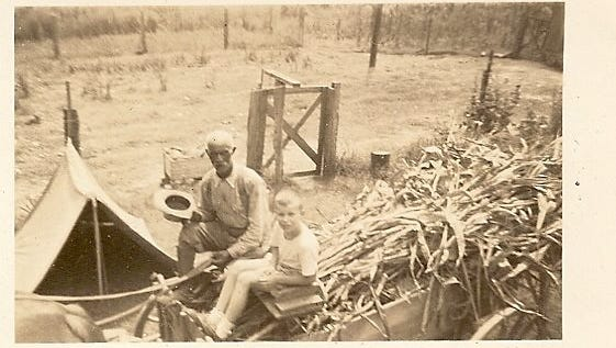 """""""Uncle Bill"""" on his wagon with young Joe Bailey, in the Bailey's back yard on Sunset Avenue, about 1947."""