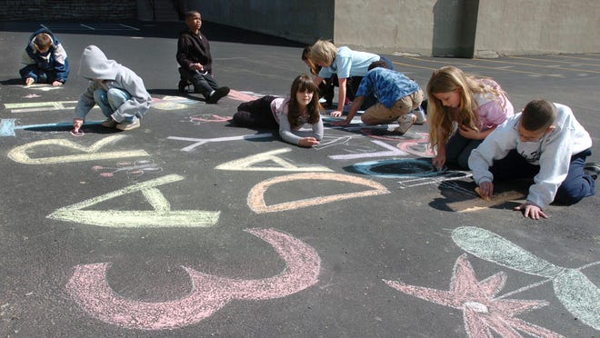 Celebrate Earth Day at Sawyer Point Park this Saturday. From 2009: Earth Day was colored onto the play ground at the Holy Family School in Price Hill by the 3rd and 4th class in chalk.