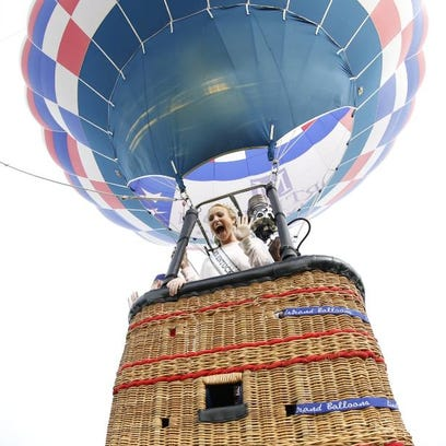 Miss Kentucky Katie George takes off in the Great Balloon