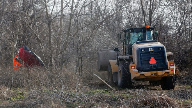 A bulldozer clears out a homeless camp near S Fort Avenue and W Phelps Street on BNSF Railroad property was broken up on Friday, Feb. 10, 2017.