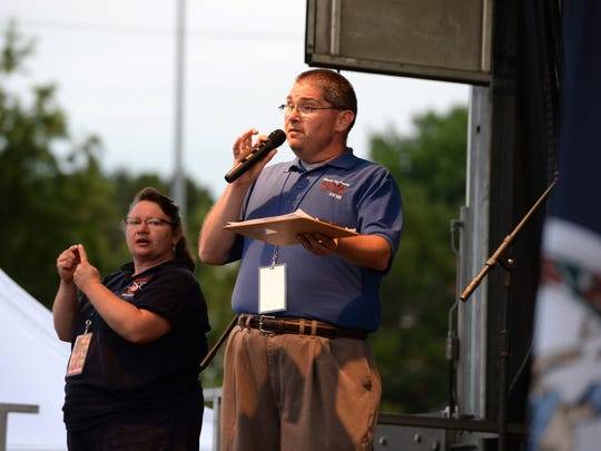 Kris Losh, who then was a WKDW radio host, introduces a band in Gypsy Hill Park on July 4, 2017 to cap America's Birthday Celebration festivities. This year Losh is listed as vice president of the organization that puts on the event.