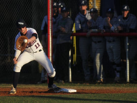 Wakulla first baseman Jared Weber catches a throw to him.