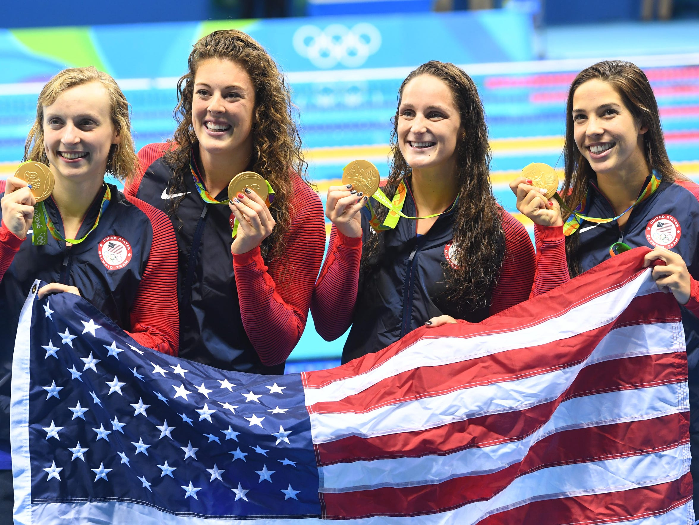 Allison Schmitt, second from left, celebrates her gold