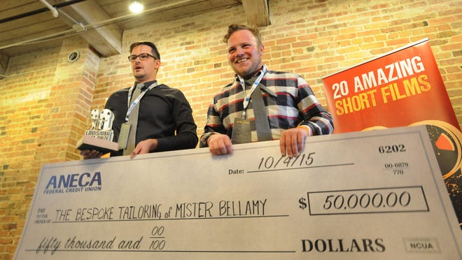 Alexander Jeffery (left) and Paul Petersen accept the Grand Prize for their film The Bespoke Tailoring of Mister Bellamy at the Louisiana Film Prize 2015 awards ceremony.