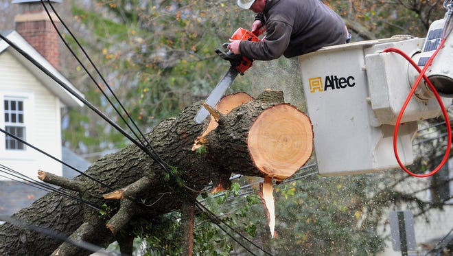 A crew works on downed power lines in Central Jersey following superstorm Sandy.