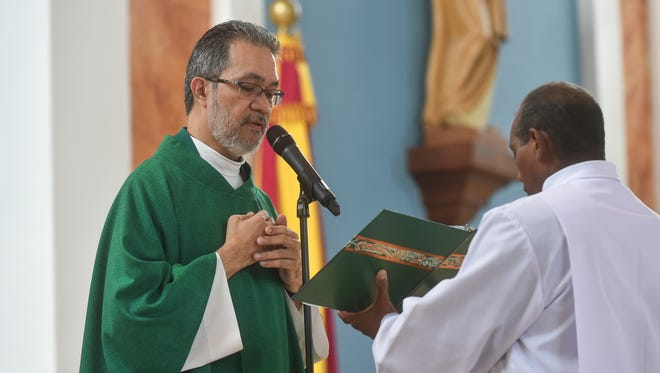 In this file photo from June, 2016, Monsignor David C. Quitugua presides over Sunday mass at Dulce Nombre de Cathedral Basilica in Hagatna.