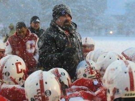 Longtime Canton coach Tim Baechler talks to his players