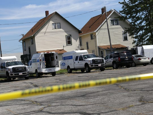 Officers from the Ashland Police Department and the Ohio Bureau of Criminal Identification and Investigation crime scene unit investigate a house on Covert Court on Sept. 13, 2016. Ashland Police Chief David Marcelli said there were two bodies found within the house.