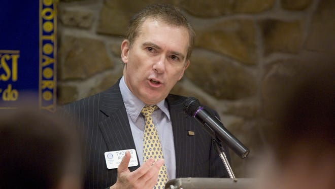 Ithaca College President Thomas Rochon speaks to the Ithaca Rotary Club in 2009.  talks about dealing with the effects of the financial crisis and broadening students' academic possibilities during his talk Wednesday to the