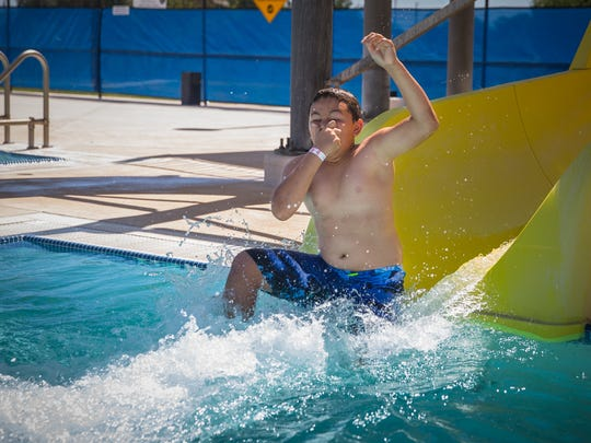 10-year-old Spencer Hart keeps cool in the hot sun by splashing into the water at Laabs Pool, June 15, 2016. Hart was one of about 60 children swimming at the pool as part of the City of Las Cruces' Parks and Recreation Department Summer Recreation Program.