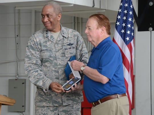 Major Gen. Leonard Isabelle presents the DFC to Thomas