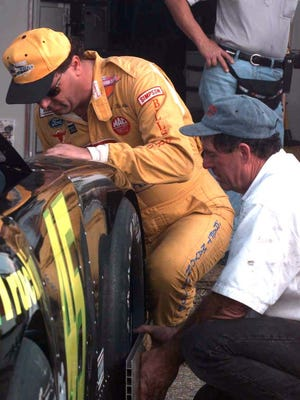 Rich Bickle works on his car during the 1998 Snowball Derby at Five Flags Speedway. Bickle went on to win the race, his fourth time to reach victory lane and would complete his five victories in 1999. Bickle, 56, is back to race again in Sunday's 50th Snowball Derby.
