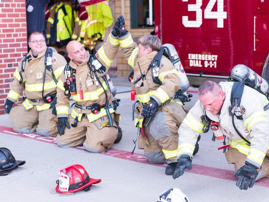 Five Millville firefighters stuck with push-up challenge